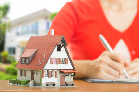 the property: Woman calculate and plan for your good property with real agency property Stock Photo