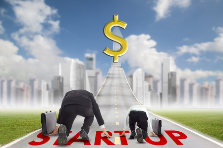 competitor: Small businessman competition with big competitor on the start up line.