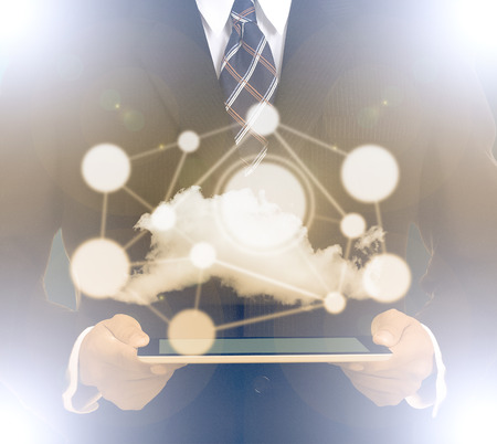 computer services: Businessman holding tablet with cloud system networking Stock Photo