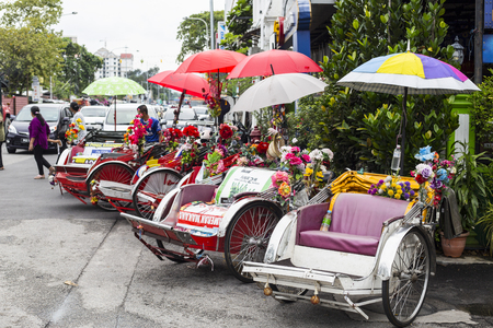trishaw: GEORGE TOWN,PENANG ,MALAYSIA- CIRCA September 06, 2015: Trishaw vintage style wait for service traveller in Georgetown, Penang, Malaysia.