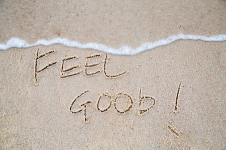 Feel good wrote on the beach outside.