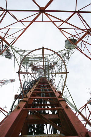 antennas: Telecommunication mast TV antennas with blue sky in the morning Stock Photo