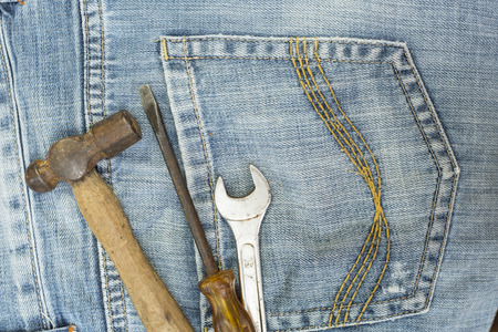 power wrench: Equipment and Tools on jean pocket.