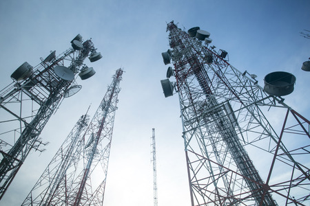 Telecommunication mast TV antennas with blue sky in the morning Foto de archivo