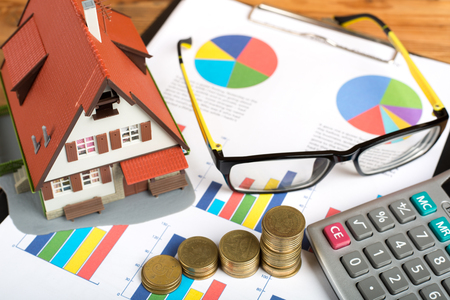 housing prices: Home and Money for your good real estate Stock Photo
