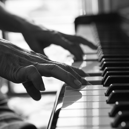 pianist: Pianist playing piano for learn melody music.
