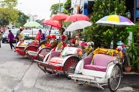 malaysia: PENANG,MALAYSIA-Sep 5 ,2015: Vintage  Trishaw stop beside road for service traveller in Penang ,Malaysia.