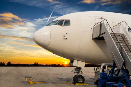 take off: Airplane stop for support service and transfer passenger with twilight time Stock Photo