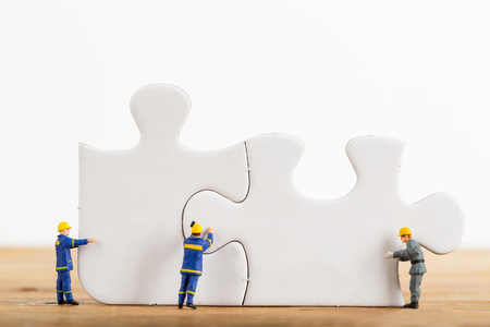 jigsaw pieces: Start up your business idea of Engineer team with jigsaw puzzle. Stock Photo