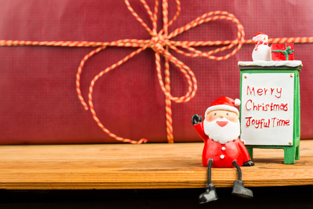 sit down: Santa claus 2016 sit down on the wood board Stock Photo
