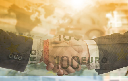 thier: Businessman shake hands for deal thier business in European