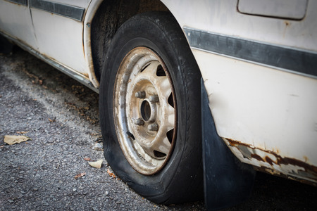 aluminum wheels: Close up Flat tire on the road waiting for repair Stock Photo