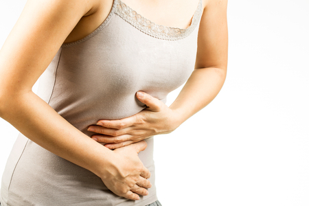 hands on stomach: Woman stomach ache with white background.