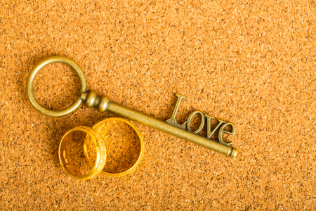 Gold heart key and engagement ring with vintage paper. Reklamní fotografie