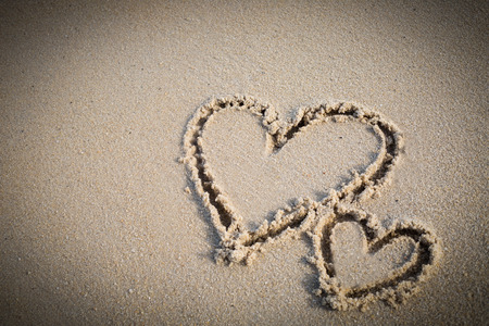 wrote: Heart twice wrote on beach.