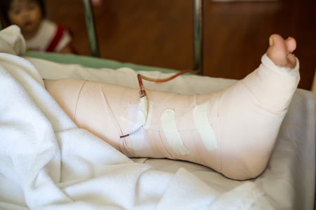 Senior adult leg injury sleeping on the bed Stock Photo