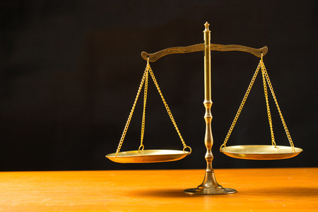 scales of justice: Justice of scale with black background. Stock Photo