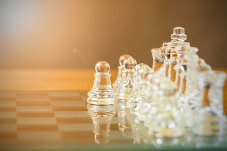 battle plan: Chess glass start up game for your business competition on chess board.