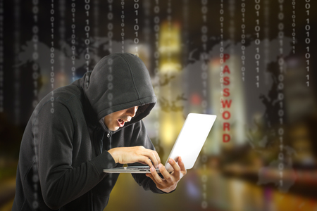 stolen data: Hackers programmer using computer laptop for hack information and data from user account.