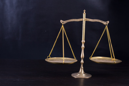 litigate: Justice of scale with books on the table