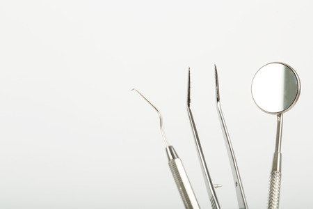 Dental tools stainless steel instrument with white background.