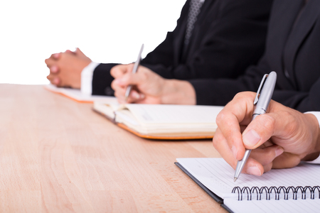 take a note: Businessman and Businesswoman take note for their business and report document.
