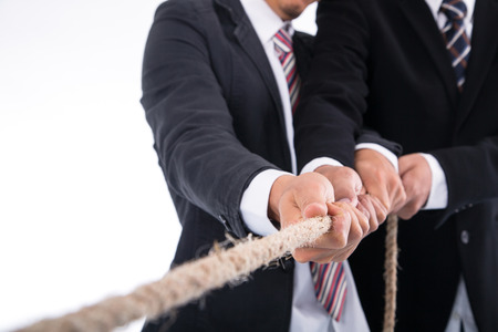 Teamwork businessman team ,team pulling rope for show power of group concept. Imagens