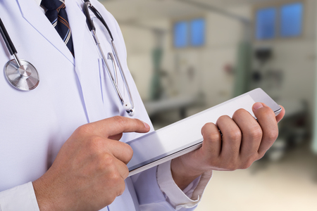 hospital patient: Doctor holding tablet for search information patient in hospital