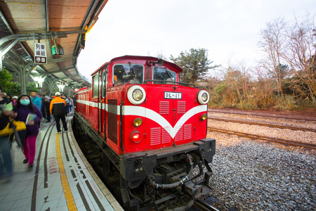 forest railway: ALISHAN JIA YI TAIWAN-MARCH 5 ,2015: Traditional Train stop in Alishan Train Station for trasport passager to see sun rise in early morning , JIA YI Province, TAIWAN