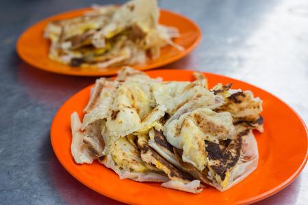 tarik: Roti canai food indea style for breakfast. Stock Photo