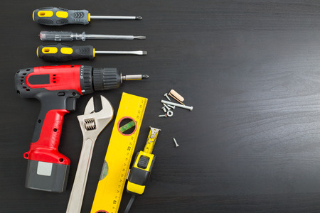 hardware tools: Tools manual hardware blank space with black wood board. Stock Photo