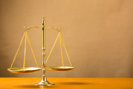 litigate: Justice of scale on table.