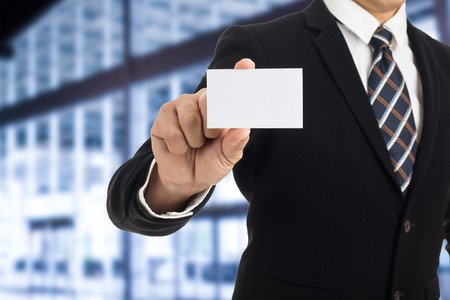 show business: Businessman show business card for introduce himself. Stock Photo