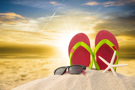 star fish: Red flip flops ,sun glass and star fish on beach in summer season.