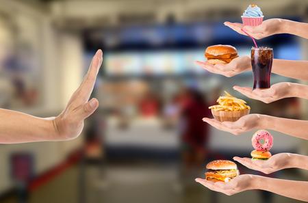 Hand refusing junk food with white background Standard-Bild