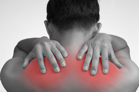tension: Shoulder pain ,red painful  tension muscle with white background. Stock Photo