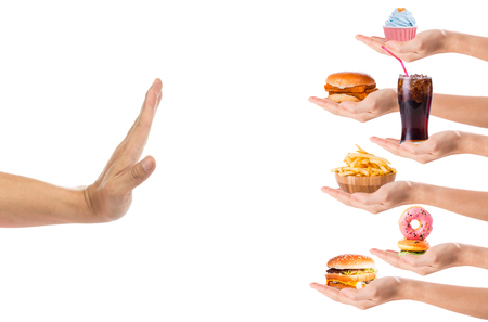 Hand refusing junk food with white background 版權商用圖片