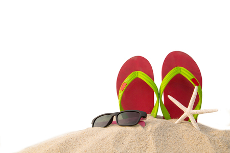 flops: Red flip flops ,sun glass and star fish on beach in summer season.