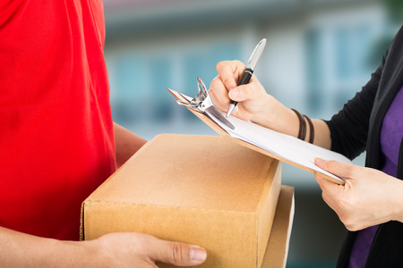 courier man: Delivery service to customer receiving package. Stock Photo