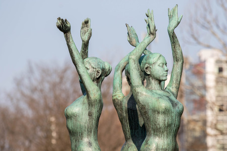 sapporo: SAPPORO ,JAPAN-April 25 ,2016: Three dance woman Bronze statues stand before sapporo tower Odori Park, Sapporo, Hokkaido, Japan Editorial