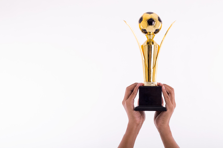 football trophy: Award football Trophy for winner achievement after win competition with isolated white background.