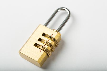 combination lock password on wood board. Imagens