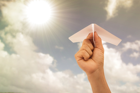 délivrance: Freedom concept with your hand.Airplane white paper holding by hand for fly as your need to do.