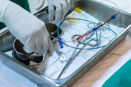 minimally: Dotor prepare equipment for percutaneous tranluminal coronary angioplasty to operate patient  who is heart disease .