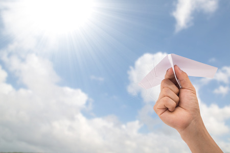 d�livrance: Freedom concept with your hand.Airplane white paper holding by hand for fly as your need to do.
