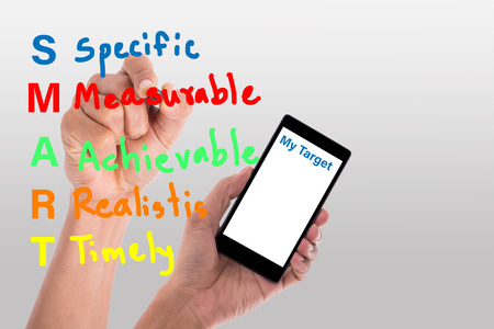 Writing smart for show my target with your smartphone for specific,measurable ,achievable ,Realistis and Timely with your hand.