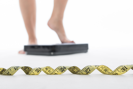 Measure scale for check your weight with white background. Stock Photo