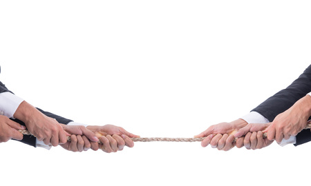 Tug of war business ,competition battle pull rope challenge concept. Stock Photo