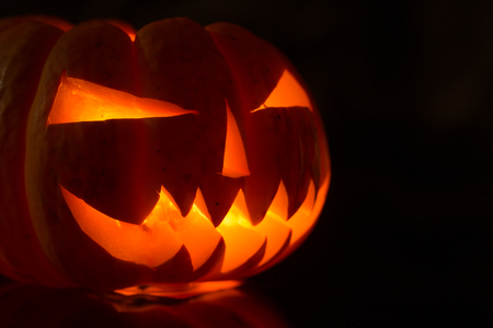 Halloween pumpkin monster scary face lantern. Stock Photo