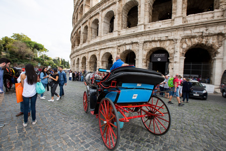 horse cart: ROME,ITALY - NOVEMBER 11,2016 : Horse cart carriage transportation front of colosseum Rome ,Italy. People walking around and sit vintage vechicle.